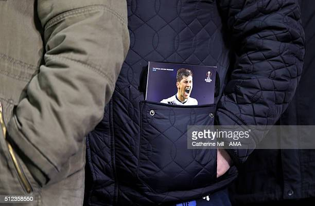 A fan with the match programmme in his pocket which has Ben Davies of Tottenham Hotspur on the cover during the UEFA Europa League match between...