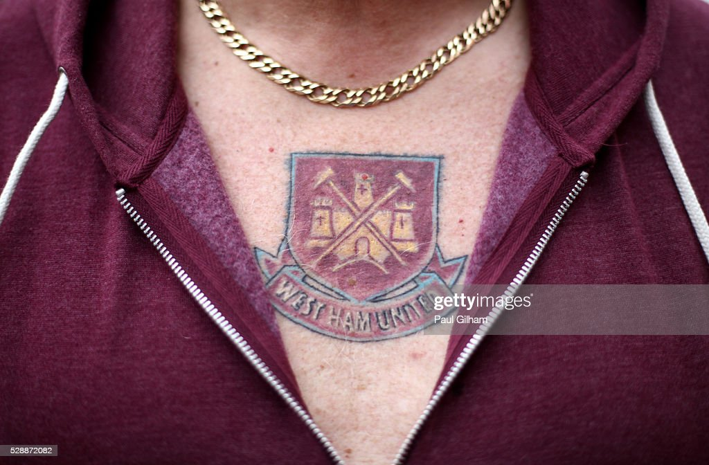 A fan with West Ham United emblem tattoo on his chest is seen prior to the Barclays Premier League match between West Ham United and Swansea City at the Boleyn Ground, May 7, 2016, London, England.