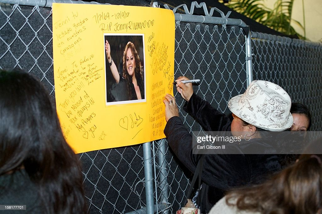 A fan writes a final farewell to the late singer Jenni Rivera at a Candlelight Vigil in her honor on December 10, 2012 in Long Beach, California.