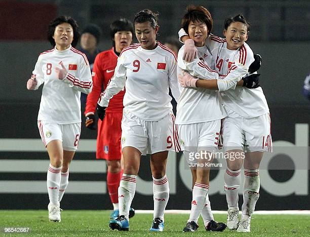 Fan Yuan of China celebrates with her teammates after scoring a goal during the East Asian Football Federation Women's Championship 2010 match...