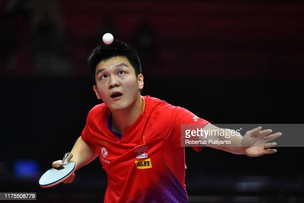 Fan Zendhong of China competes against Jeoung Youngsik of Korea during Men's Team Champions Division final match on day four of the ITTF-Asian Table...