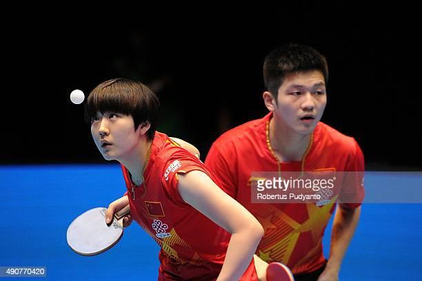 Fan Zhendong and Chen Meng of China compete against Oshima Yuya and Wakamiya Misako of Japan during Mixed doubles semi-final match of the 22nd 2015...