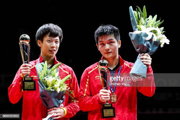 Fan Zhendong and Lin Gaoyuan of China attend the award ceremony at the men's doubles final compete with Ionescu Ovidiu of Romania and Robles Alvaro...