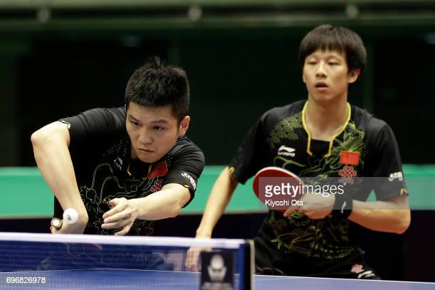 Fan Zhendong and Lin Gaoyuan of China compete in the Men's Doubles semi final match against Ma Long and Xu Xin of China during day four of the 2017...