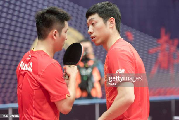 Fan Zhendong and Xu Xin of China compete during the men's doubles semifinal match against Tomokazu Harimoto and Yuto Kizukuri of Japan on the day two...