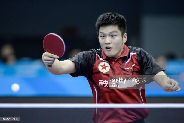 Fan Zhendong competes against Ma Long during the Men's singles table tennis final match of the 13th Chinese National Games on September 6 2017 in...