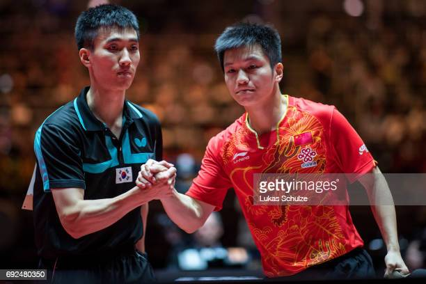 Fan Zhendong of China and Lee Sangsu of Korea shake hands after the Men's Singles Semi Final match of the Table Tennis World Championship at Messe...