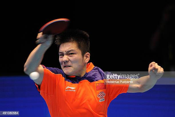 Fan Zhendong of China competes against Chuang ChihYuan of Taipei during Men's singles semifinal match of the 22nd 2015 ITTF Asian Table Tennis...