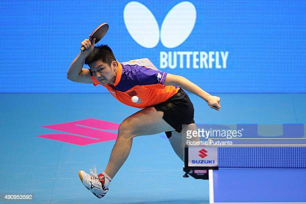 Fan Zhendong of China competes against Fang Bo of China during Men's singles quarterfinal match of the 22nd 2015 ITTF Asian Table Tennis...