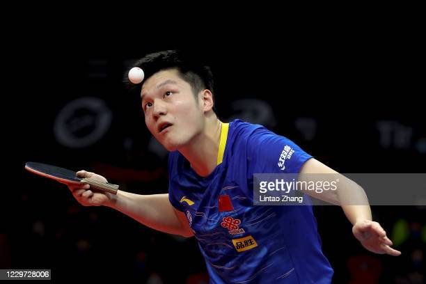 Fan Zhendong of China competes against Ma Long of China during men's single final match on day four of 2020 ITTF Finals at Zhengzhou Olympic Sports...