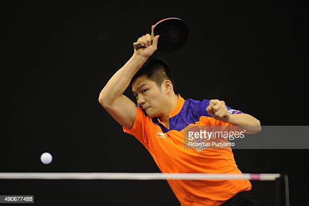 Fan Zhendong of China competes against Saif Ibrahim of United Arab Emirates during Men's singles first round match of the 22nd 2015 ITTF Asian Table...