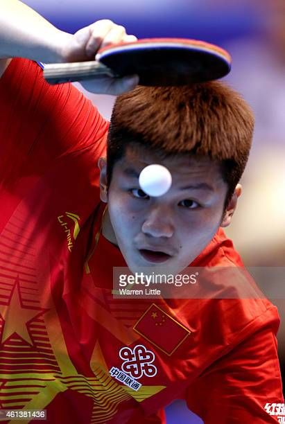 Fan Zhendong of China in action against Daniel Habesohn of Austria during the Men's Final of the 2015 ITTF World Team Cup at Al Nasr Sports Stadium...