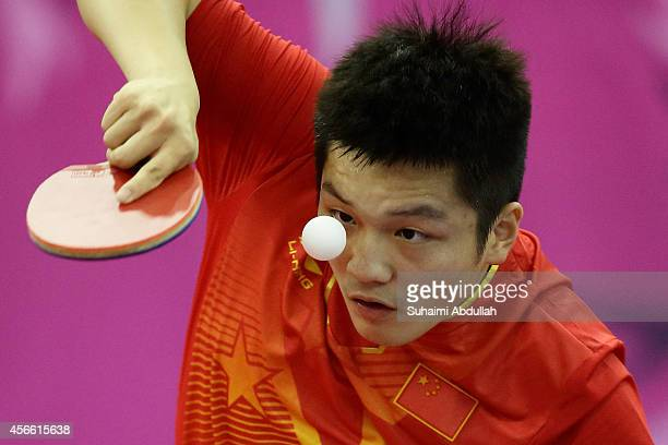 Fan Zhendong of China in action during the men'ss singles semifinal match 2 table tennis on day fifteen of the 2014 Asian Games match at Suwon...