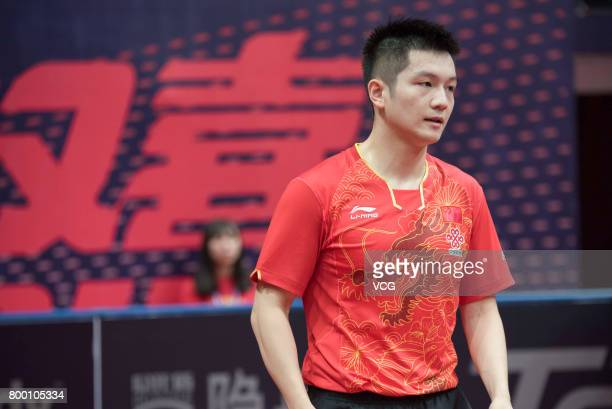 Fan Zhendong of China reacts after losing the men's doubles semifinal match against Tomokazu Harimoto and Yuto Kizukuri of Japan on the day two of...