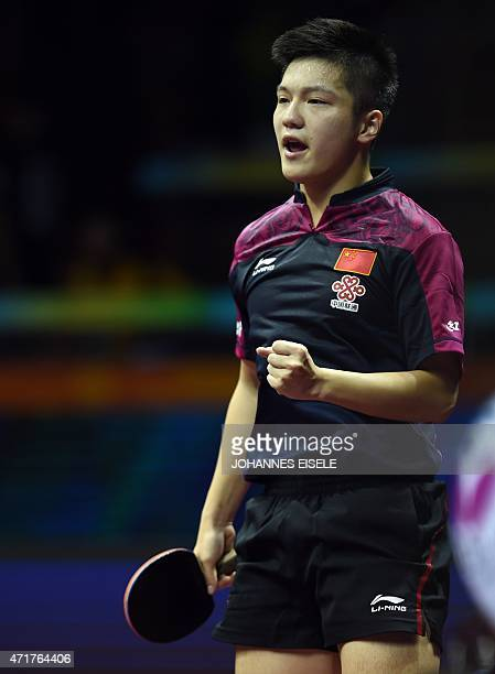 Fan Zhendong of China reacts during his men's singles match against Niwa Koki of Japan at the 2015 World Table Tennis Championships at the Suzhou...