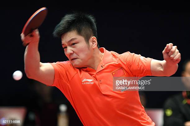 Fan Zhendong of China returns the ball during a men's singles semifinal match against Chuang ChihYuan of Taiwan at the Asian Table Tennis...