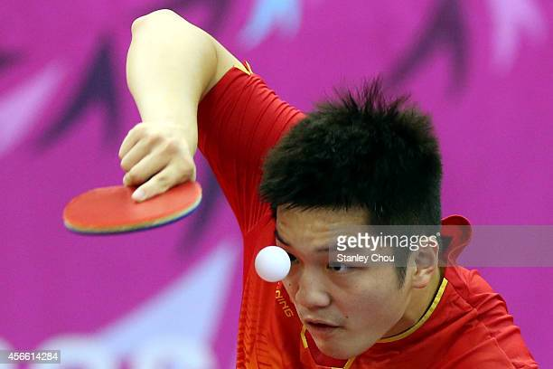 Fan Zhendong of China serves a shot to Chuang Chih Yuan of Chinese Taipei during the Men's Semi Final match during the day fifteen of the 2014 Asian...