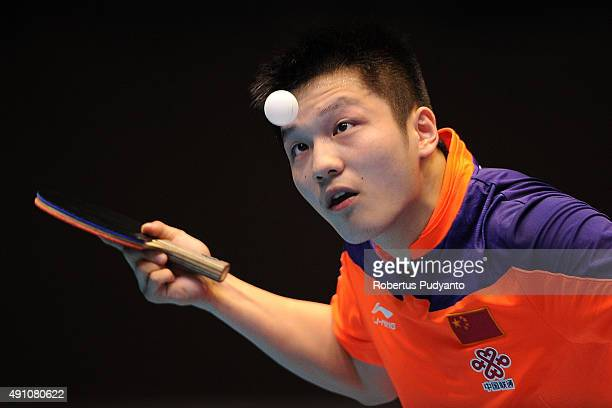 Fan Zhendong of China serves against Chuang ChihYuan of Taipei during Men's singles semifinal match of the 22nd 2015 ITTF Asian Table Tennis...