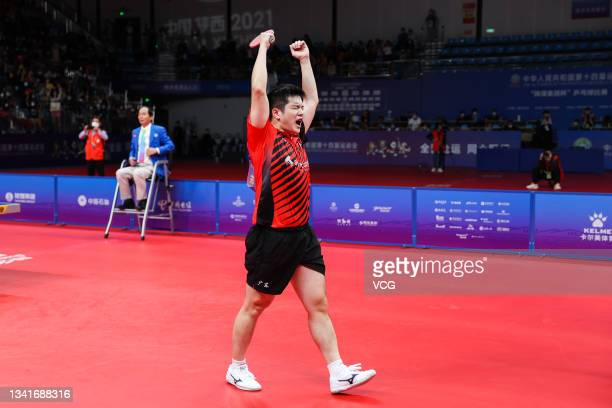 Fan Zhendong of Guangdong celebrates after winning the Men's Table Tennis Group Final Match against Beijing during China's 14th National Games at...
