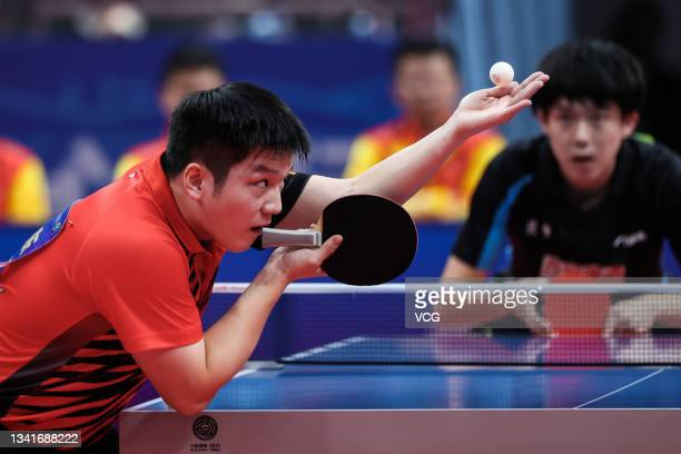 Fan Zhendong of Guangdong competes in the Men's Table Tennis Group Final Match against Wang Chuqin of Beijing during China's 14th National Games at...