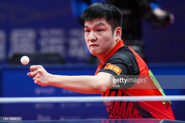 Fan Zhendong of Guangdong competes in the Men's Table Tennis Group Final Match against Beijing during China's 14th National Games at Yan'an...