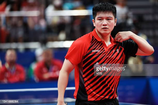 Fan Zhendong of Guangdong reacts in the Men's Table Tennis Group Final Match against Beijing during China's 14th National Games at Yan'an University...