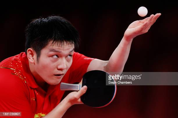 Fan Zhengdong of Team China serves the ball during his Men's Singles Semifinals match on day six of the Tokyo 2020 Olympic Games at Tokyo...