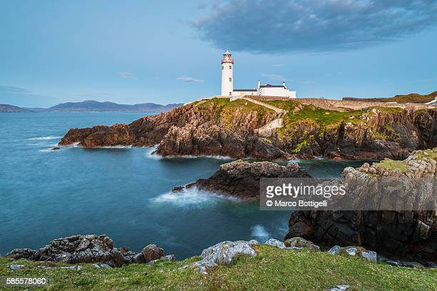 Fanad Head (Fánaid) lighthouse, County Donegal, Ulster region, Ireland, Europe. Lighthouse and its cove at dusk.