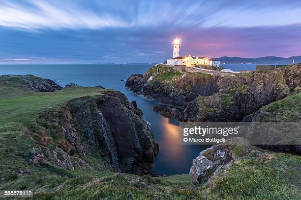 Fanad Head (Fánaid) lighthouse, County Donegal, Ulster region, Ireland, Europe. Lighthouse and its cove at night.