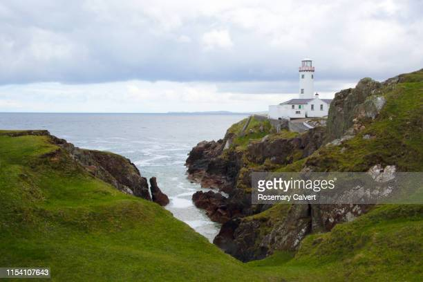 fanad head lighthouse in rocky coastal landscape, ireland. - ulster province stock pictures, royalty-free photos & images
