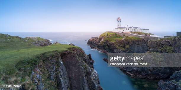 fanad head lighthouse, ireland. - cape stock pictures, royalty-free photos & images
