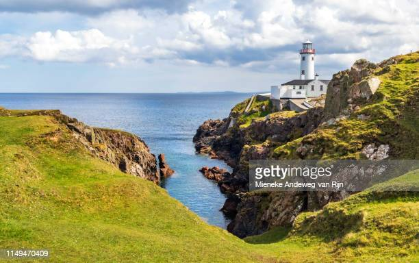 fanad head lighthouse, on fanad peninsula, overlooking the atlantic ocean, county donegal, republic of ireland - clear sky stock pictures, royalty-free photos & images