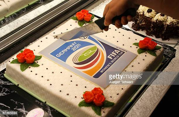 A fance cake with the logo of the 2011 Women's Football World Championships is cut on August 15 2008 in Leverkusen Germany Officials from DFB and...