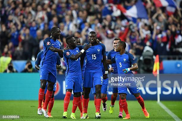 Fance teammates celebrate with scorer France's midfielder Paul Pogba the team's second goal during the Euro 2016 quarterfinal football match between...