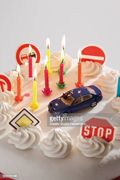 Fancy cake with road signs and toy car, elevated view