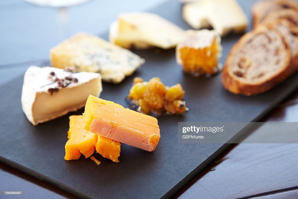 Fancy cheese plate with bread and honey : Stock Photo