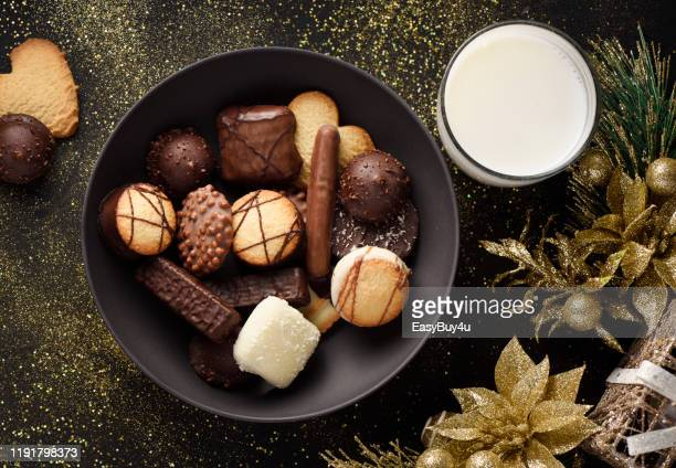 fancy chocolate cookies and milk - belgian culture stock pictures, royalty-free photos & images