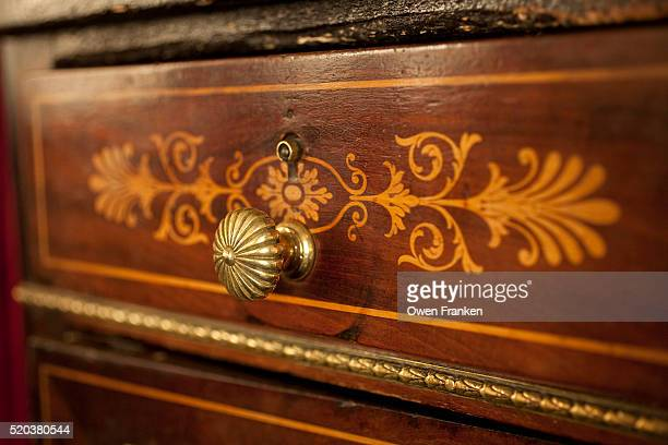 fancy decoration on a drawer at le grand vefour restaurant, paris - palais royal stock pictures, royalty-free photos & images