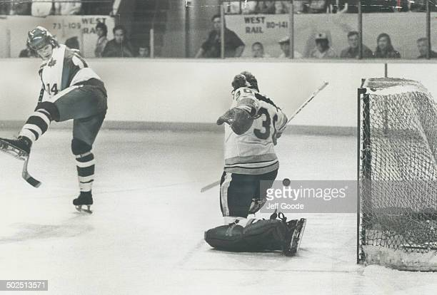 Fancy move: Toronto Marlboros' ace Mark Napier deflects a shot with a slick move between his legs; but New Westminster goalie Gord Laxton manages to...