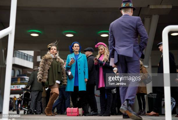 Fancy outfits during Ladies Day during day two of the Cheltenham National Hunt Racing Festival at Cheltenham Racecourse on March 11th 2020 in...