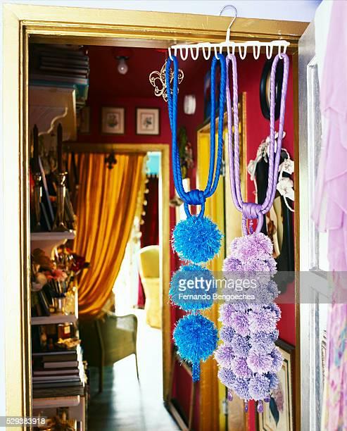 fancy tassels hanging in gilt doorway - fernando bengoechea stock pictures, royalty-free photos & images