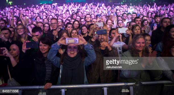 Fand cheer while the British band The xx performs live during a concert at the Arena on February 25 2017 in Berlin Germany