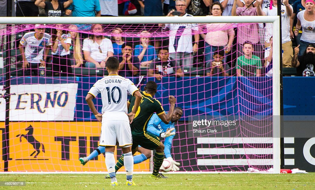 Fanendo Adi #9 of Portland Timbers scores a penalty kick as Donovan Ricketts #1 of Los Angeles Galaxy attempts to make a save during Los Angeles Galaxy's MLS match against Portland Timbers at the StubHub Center on October 18, 2015 in Carson, California. The Portland Timbers won the match 5-2