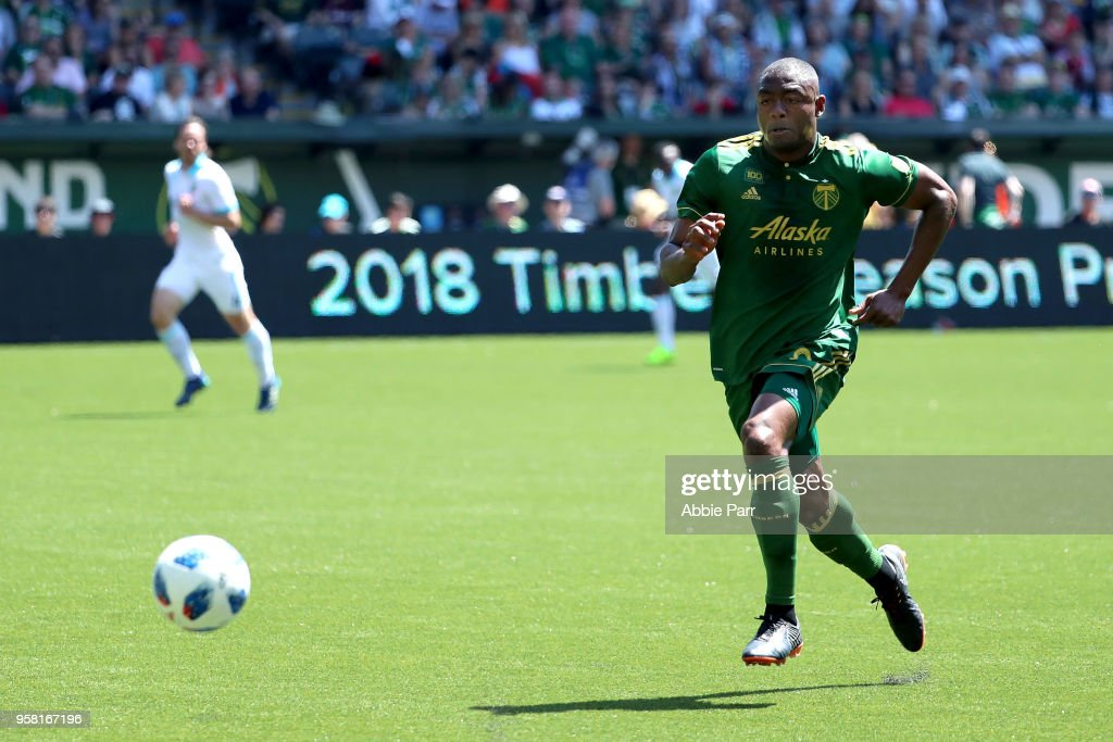 Fanendo Adi #9 of the Portland Timbers dribbles with the ball in the first half against the Seattle Sounders during their game at Providence Park on May 13, 2018 in Portland, Oregon.