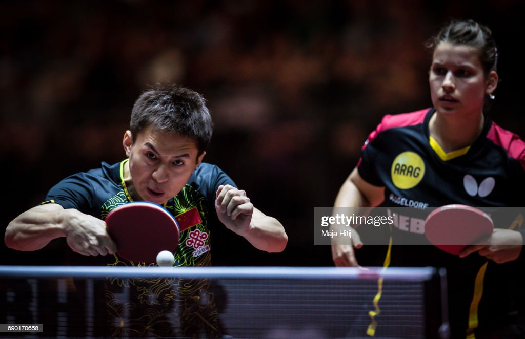 Fang Bo of China and Petrissa Solja of Germany compete during mixed double 1. round at Table Tennis World Championship at Messe Duesseldorf on May 30, 2017 in Dusseldorf, Germany.