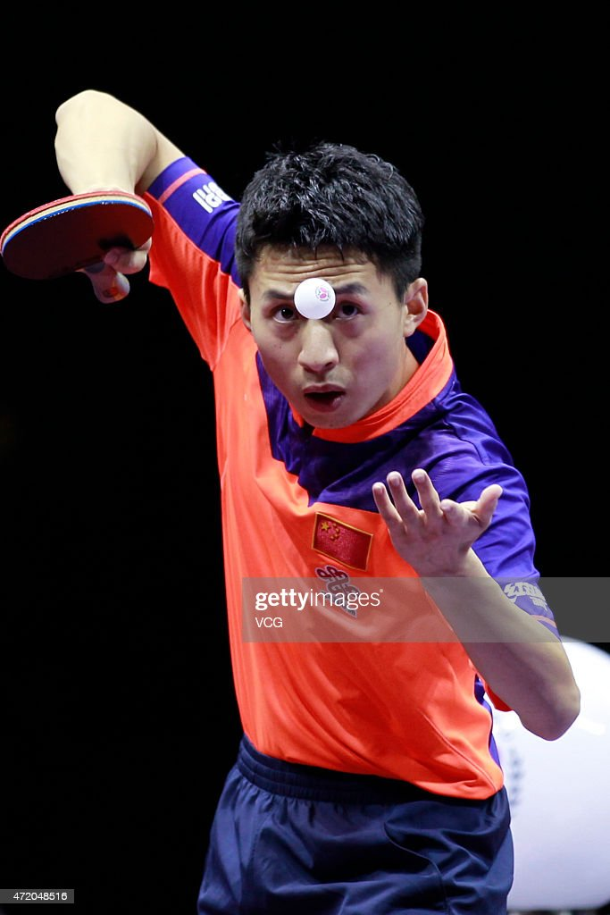 Fang Bo of China competes against Ma Long of China during men's singles final match on day eight of the 2015 World Table Tennis Championships at the Suzhou International Expo Center on May 3, 2015 in Suzhou, China.