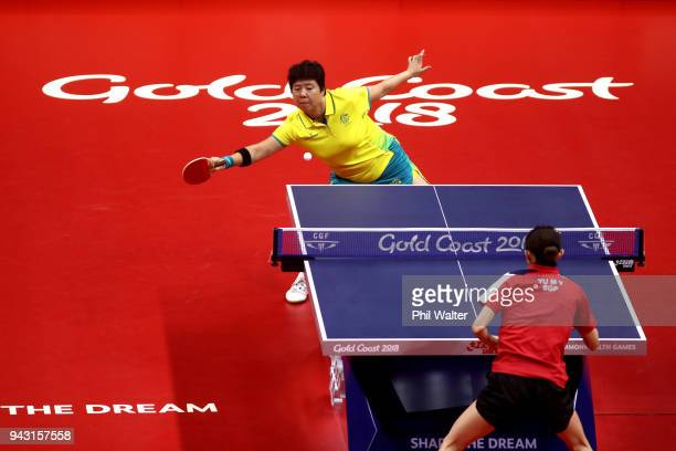 Fang Jian Lay of Australia plays a forehand in her Womens Team match against Mengyu Yu of Singapore during Table Tennis on day four of the Gold Coast...