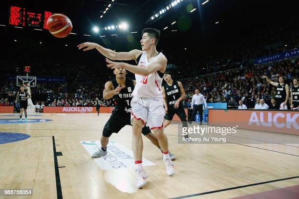 Fang Shuo of China competes against Mika Vukona of New Zealand during the FIBA World Cup Qualifying match between the New Zealand Tall Blacks and...