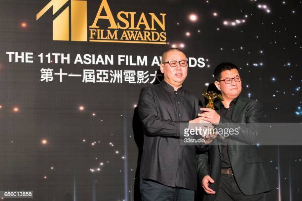 Fang Tao and Hao Zhiyu, winners of the Best Sound award for 'Crosscurrent', poses with the award during the 11th Asian Film Awards on March 21, 2017...
