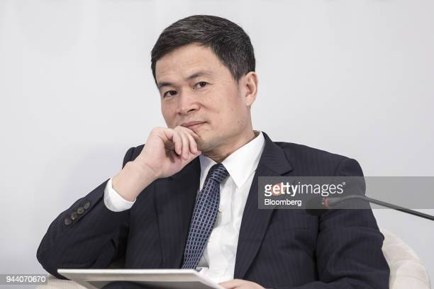 Fang Xinghai vice chairman of the China Securities Regulatory Commission listens during a session at the Boao Forum for Asia Annual Conference in...